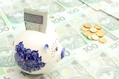 Piggy bank, money and coins on heap of banknotes Stock Photography
