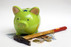 Piggy bank, money and hammer Royalty Free Stock Images