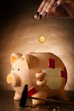 Piggy bank with money and hammer Stock Photo