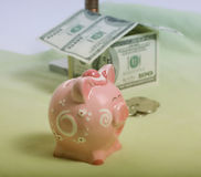 Piggy Bank and money house Royalty Free Stock Images