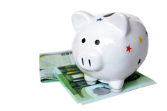 Piggy bank and money isolated Stock Photos