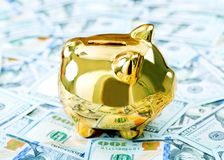 Piggy bank and money. On a table Royalty Free Stock Photos