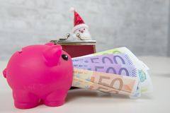 Piggy bank and money with Santa Claus. A piggy bank and money with Santa Claus Royalty Free Stock Images