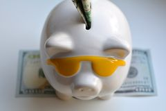 Piggy bank and money savings. On a white background Stock Photo