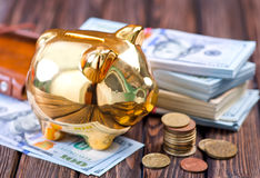 Piggy bank and money. On a table Stock Photo
