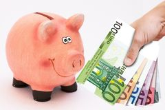 Piggy bank and money tower Royalty Free Stock Photos