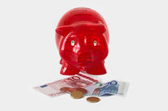 Piggy bank with money Royalty Free Stock Photos