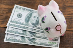 Piggy bank and money Stock Photos
