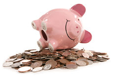 Piggy bank moneybox with British currency coins. Studio cutout Royalty Free Stock Photography