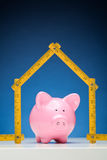 Piggy Bank and New Home Stock Photography