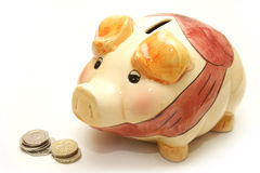 Piggy Bank Next to Coins Stock Photography