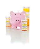 Piggy Bank and Non-Proprietary Medicine Prescription Bottles Iso Royalty Free Stock Image