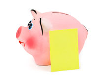 Piggy bank and note paper Royalty Free Stock Photo