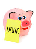 Piggy bank and note paper Stock Images
