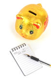 Piggy bank and notepad Stock Photo