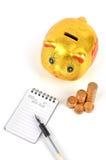 Piggy bank and notepad Royalty Free Stock Photos