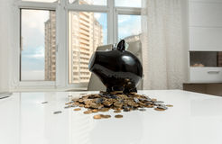Piggy bank on office table against city view Stock Photo