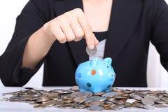 Piggy bank officer put money inside Royalty Free Stock Photo