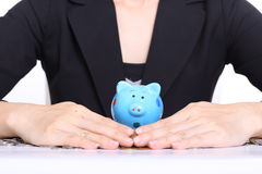 Piggy bank officer put money inside Stock Photo