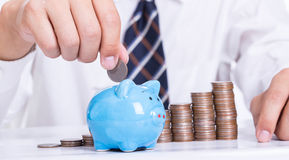 Piggy bank officer put money Royalty Free Stock Photography