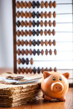 Piggy bank on old book Stock Photography