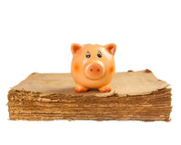 Piggy bank on the old book Stock Photography