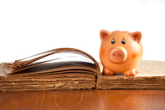 Piggy bank on the old book Royalty Free Stock Photo