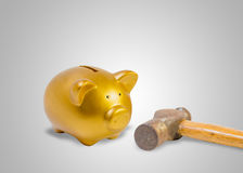 Piggy bank and old hammer save money Royalty Free Stock Photos