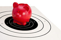 Piggy Bank On Bulls Eye (Financial Security) Stock Images
