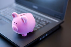 Piggy Bank On Laptop Royalty Free Stock Photography