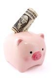 Piggy bank with one dollar bill Stock Photos