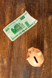 Piggy bank and one hundred belorussian rubles Stock Image