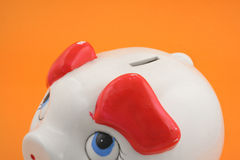 Piggy bank on orange Royalty Free Stock Photography
