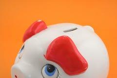 Piggy bank on orange Royalty Free Stock Photography