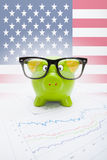 Piggy bank over stock market chart with USA flag on background - part of series Royalty Free Stock Image