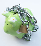 Piggy bank with padlock. A piggy bank with a chain and padlock - symbolic for safety precautions on saving Royalty Free Stock Photos