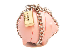 Piggy bank padlocked with chains and padlock Stock Images