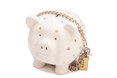 Piggy bank padlocked with chains and padlock Royalty Free Stock Photography