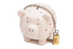 Piggy bank padlocked with chains and padlock Stock Photos