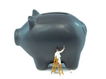 Piggy bank and painter Stock Photos