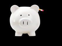 Piggy Bank With Pencil Behind Ear Stock Photos
