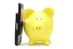 Piggy bank on phone Royalty Free Stock Images
