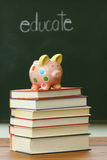 Piggy bank on a pile of books Royalty Free Stock Photo