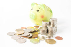 Piggy bank on a pile of coins Royalty Free Stock Photos