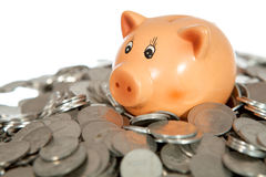 Piggy bank on pile of coins Royalty Free Stock Image