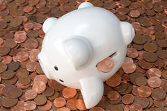 Piggy bank on pile of copper coins Stock Image