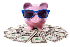 Piggy Bank, pile of dollars, summer vacation travel saving concept Royalty Free Stock Photography