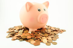 A piggy bank on a pile of euro cent coins. Isolated on white.  Business & Finance Collection Stock Photo