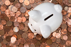 Piggy bank on pile of Euro cents Royalty Free Stock Images