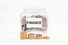 Piggy bank, pile gold coin, with word text Finance on paper Royalty Free Stock Photo